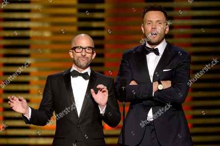 Jim Rash and Joel McHale speak on stage at the Television Academy's Creative Arts Emmy Awards at the Nokia Theater L.A. LIVE, in Los Angeles