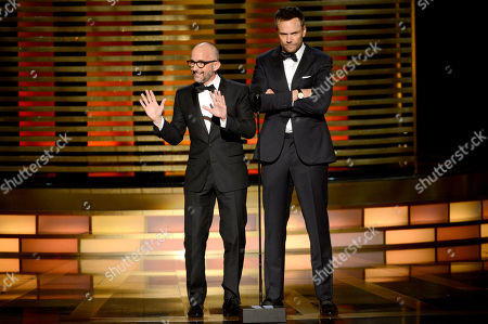 Jim Rash, left, and Joel McHale speak on stage at the Television Academy's Creative Arts Emmy Awards at the Nokia Theater L.A. LIVE, in Los Angeles