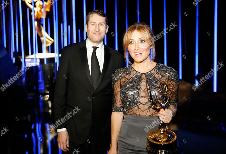 Scott Aukerman, left, and Sasha Alexander seen backstage at the Television Academy's Creative Arts Emmy Awards at Microsoft Theater, in Los Angeles