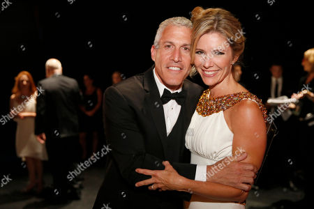 Tava Smiley, right, and Brian Katkin pose backstage at the Television Academy's Creative Arts Emmy Awards at Microsoft Theater, in Los Angeles