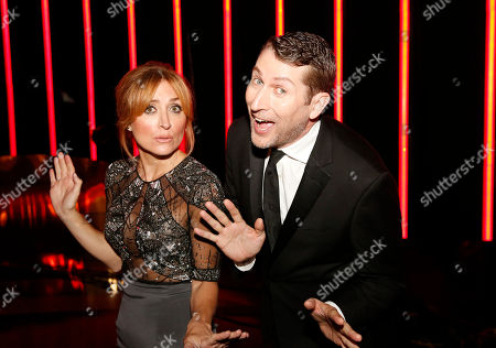 Sasha Alexander, left, and Scott Aukerman pose backstage at the Television Academy's Creative Arts Emmy Awards at Microsoft Theater, in Los Angeles