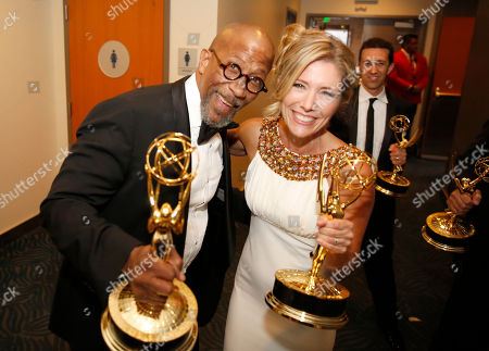Reg E. Cathey and Tava Smiley pose backstage at the Television Academy's Creative Arts Emmy Awards at Microsoft Theater, in Los Angeles
