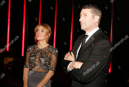 Sasha Alexander, left, and Scott Aukerman are seen backstage at the Television Academy's Creative Arts Emmy Awards at Microsoft Theater, in Los Angeles