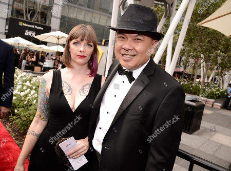 Bernie Su, right, arrives at the Television Academy's Creative Arts Emmy Awards at Microsoft Theater, in Los Angeles