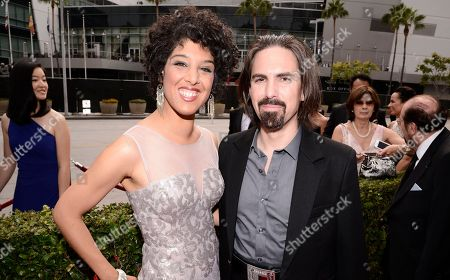 Raya Yarbrough, left, and Bear McCreary arrive at the Television Academy's Creative Arts Emmy Awards at Microsoft Theater, in Los Angeles