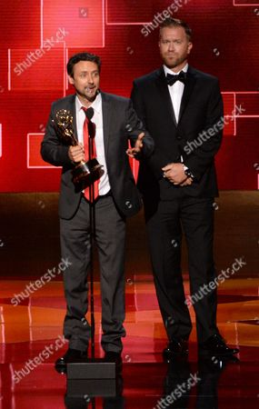 Kyle Dunnigan, left, and Jim Roach accept the award for outstanding original music and lyrics for their work on Inside Amy Schumer at the Television Academy's Creative Arts Emmy Awards at Microsoft Theater, in Los Angeles