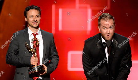Kyle Dunnigan, left, and Jim Roachthe accept the award for outstanding original music and lyrics for Inside Amy Schumer at the Television Academy's Creative Arts Emmy Awards at Microsoft Theater, in Los Angeles