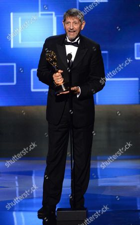 Peter Coyote accepts the award for outstanding narrator for his work on The Roosevelts: An Intimate History at the Television Academy's Creative Arts Emmy Awards at Microsoft Theater, in Los Angeles