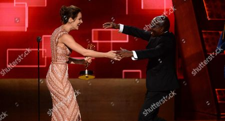 EXCLUSIVE - Katharine McPhee, left, presents the award for outstanding music direction to Greg Phillinganes for his work on Stevie Wonder: Songs In The Key Of Life - An All-Star GRAMMY Salute at the Television Academy's Creative Arts Emmy Awards at Microsoft Theater, in Los Angeles