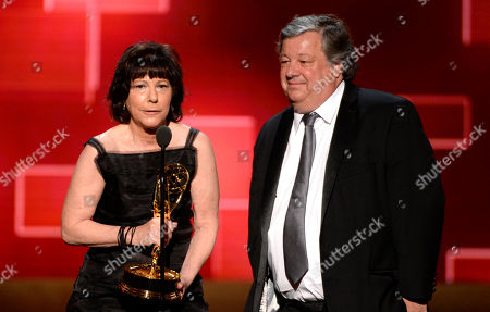 Karen Goodman, left, and Kirk Simon accept the award for outstanding children's program for 'Alan Alda And The Actor Within You: A YoungArts Masterclass'? at the Television Academy's Creative Arts Emmy Awards at Microsoft Theater, in Los Angeles