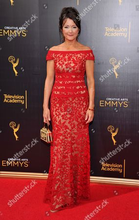 Stock Image of Lisa Waltz arrives at night two of the Television Academy's 2016 Creative Arts Emmy Awards at the Microsoft Theater on in Los Angeles