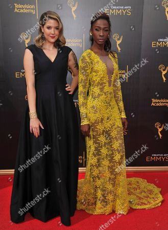 Laura Zak, left, and Angelica Ross arrive at night two of the Television Academy's 2016 Creative Arts Emmy Awards at the Microsoft Theater on in Los Angeles