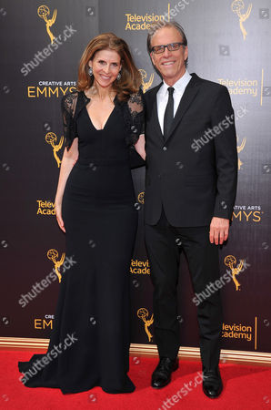 Amy Ziering, left, and Kirby Dick arrive at night two of the Television Academy's 2016 Creative Arts Emmy Awards at the Microsoft Theater on in Los Angeles