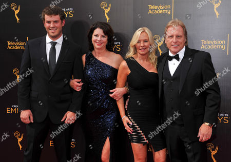 Sean Dwyer, left, and Sig Hansen, right, arrive at night two of the Television Academy's 2016 Creative Arts Emmy Awards at the Microsoft Theater on in Los Angeles