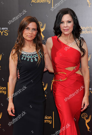 Lati Grobman, from left, and Christa Campbell arrive at night two of the Television Academy's 2016 Creative Arts Emmy Awards at the Microsoft Theater on in Los Angeles
