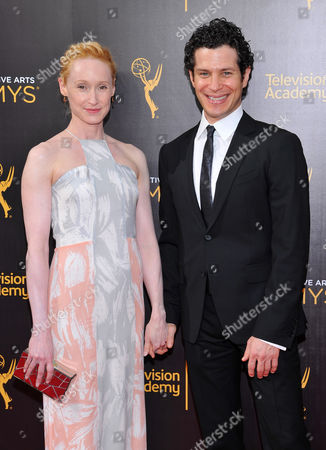 Angela Christian, left, and Thomas Kail arrive at night two of the Television Academy's 2016 Creative Arts Emmy Awards at the Microsoft Theater on in Los Angeles