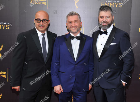 David Dinerstein, from left, Dan Tolmer, and Evgeny Afineevsky arrive at night two of the Television Academy's 2016 Creative Arts Emmy Awards at the Microsoft Theater on in Los Angeles