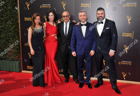 Lati Grobman, from left, Christa Campbell, David Dinerstein, Dan Tolmer, and Evgeny Afineevsky arrive at night two of the Television Academy's 2016 Creative Arts Emmy Awards at the Microsoft Theater on in Los Angeles