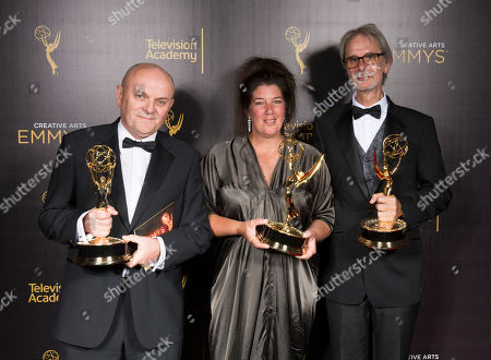 """Stock Picture of Donal Woods, from left, LInda Wilson, and Mark Kebby winners of the award for outstanding production design for a narrative period program (one hour or more) for """"Downton Abbey"""" pose for a portrait during night one of the Television Academy's 2016 Creative Arts Emmy Awards at the Microsoft Theater on in Los Angeles"""