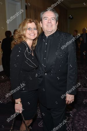 "Jimmy Webb, right, and Laura Savini attend the 22nd annual ""A Night At Sardi's"" to benefit the Alzheimer's Association at the Beverly Hilton Hotel, in Beverly Hills, Calif"