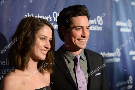 """Michelle Mulitz, left, and Ben Feldman arrive at the 22nd annual """"A Night At Sardi's"""" to benefit the Alzheimer's Association at the Beverly Hilton Hotel, in Beverly Hills, Calif"""