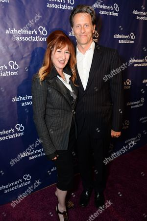 "Vicki Lewis, left, and Steven Weber arrive at the 22nd annual ""A Night At Sardi's"" to benefit the Alzheimer's Association at the Beverly Hilton Hotel, in Beverly Hills, Calif"