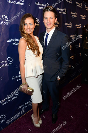 """Angela Stacy, left, and Matt Lanter arrive at the 22nd annual """"A Night At Sardi's"""" to benefit the Alzheimer's Association at the Beverly Hilton Hotel, in Beverly Hills, Calif"""