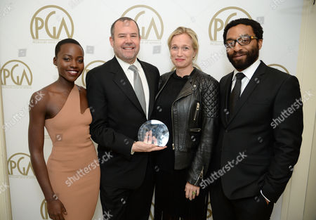 From left, Stewart Lyons, Lupita Nyong'o, Michelle MacLaren and Chiwetel Ejiofor pose backstage at the 25th annual Producers Guild of America (PGA) Awards at the Beverly Hilton Hotel, in Beverly Hills, Calif