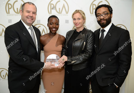 From left, Marc Shmuger, Lupita Nyong'o, Michelle MacLaren, Alexis Bloom and Chiwetel Ejiofor pose backstage at the 25th annual Producers Guild of America (PGA) Awards at the Beverly Hilton Hotel, in Beverly Hills, Calif