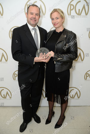 Marc Shmuger (L) and Alexis Bloom accept the Award for Outstanding Producer of Documentary Theatrical Motion Pictures for 'We Steal Secrets: The Story of WikiLeaks' at the 25th annual Producers Guild of America (PGA) Awards at the Beverly Hilton Hotel, in Beverly Hills, Calif