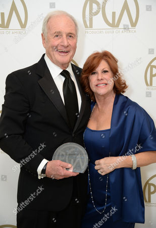 Jerry Weintraub with the award for outstanding producer of non-fiction television for 'Behind the Candelabra' and Susan Ekins backstage at the 25th annual Producers Guild of America (PGA) Awards at the Beverly Hilton Hotel, in Beverly Hills, Calif