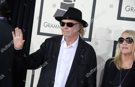 Neil Young, left, and Pegi Young arrive at the 56th annual GRAMMY Awards at Staples Center, in Los Angeles