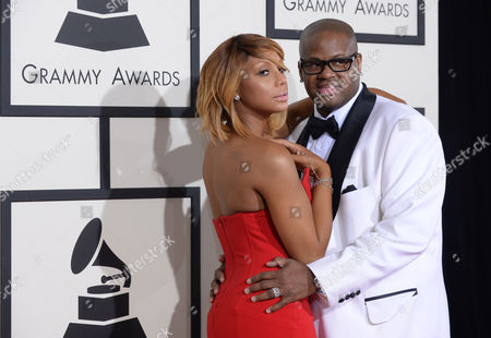 Tamar Braxton, left, and Vince Herbert arrive at the 56th annual GRAMMY Awards at Staples Center, in Los Angeles