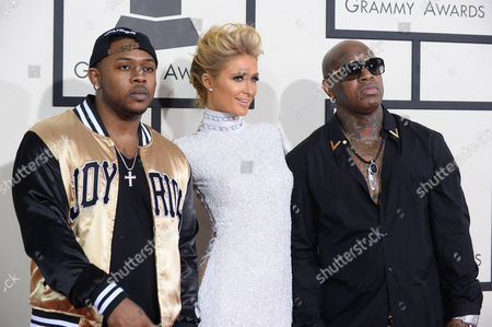 From left, Mack Maine, Paris Hilton and Birdman arrive at the 56th annual GRAMMY Awards at Staples Center, in Los Angeles