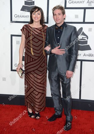Jorja Fox and Eric Szmanda arrive at the 56th annual GRAMMY Awards at Staples Center, in Los Angeles