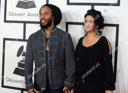 Ziggy Marley, left, and Orly Marley arrive at the 56th annual GRAMMY Awards at Staples Center, in Los Angeles