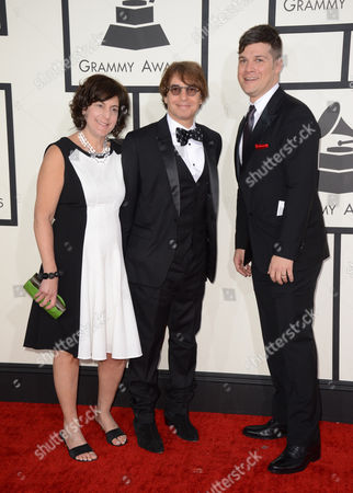 Stephen Oremus, right, and guests arrives at the 56th annual GRAMMY Awards at Staples Center, in Los Angeles