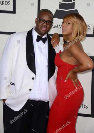 Stock Image of Vince Herbert, left, and Tamar Braxton arrive at the 56th annual GRAMMY Awards at Staples Center, in Los Angeles