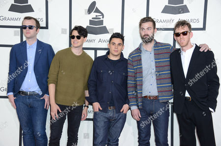 From left, Chris Baio, Ezra Koenig, Rostam Batmanglij, Chris Tomson of Vampire Weekend and producer Ariel Rechtshaid arrives at the 56th annual GRAMMY Awards at Staples Center, in Los Angeles