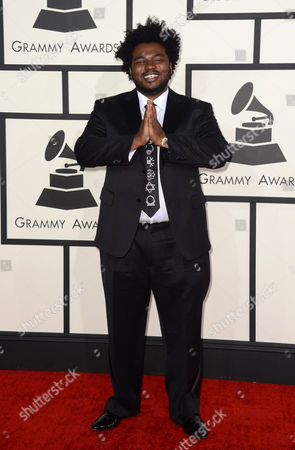 Stock Image of James Fauntleroy arrives at the 56th annual GRAMMY Awards at Staples Center, in Los Angeles