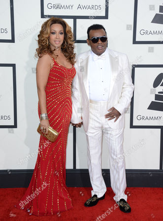 Stock Image of Kandy Johnson Isley and Ronald Isley arrive at the 56th annual GRAMMY Awards at Staples Center, in Los Angeles