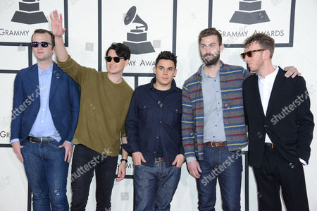 Chris Baio, from left, Ezra Koenig, Rostam Batmanglij, Chris Tomson of Vampire Weekend and arrive with a guest at the 56th annual Grammy Awards at Staples Center, in Los Angeles