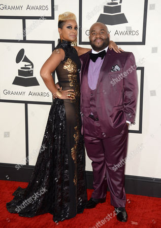 April Daniels, left, and LaShawn Daniels arrive at the 56th annual GRAMMY Awards at Staples Center, in Los Angeles