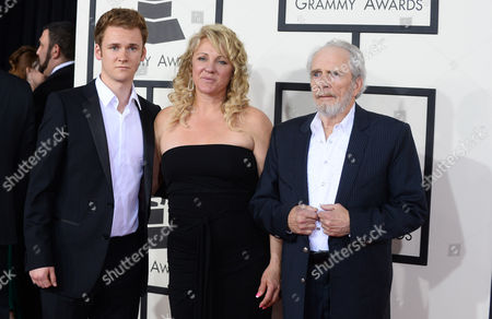 From left, Ben Haggard, Theresa Ann Lane and Merle Haggard arrive at the 56th annual GRAMMY Awards at Staples Center, in Los Angeles
