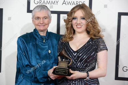 Karen A. Shaffer, left, and Rachel Barton Pine with the Lifetime Achievement Grammy on behalf of Maud Powell arrive at the 56th annual Grammy Awards at Staples Center, in Los Angeles