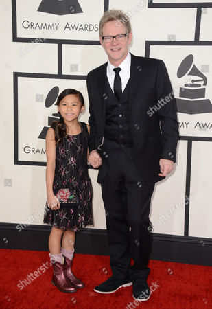 Steven Curtis Chapman, right, and daughter arrive at the 56th annual GRAMMY Awards at Staples Center, in Los Angeles