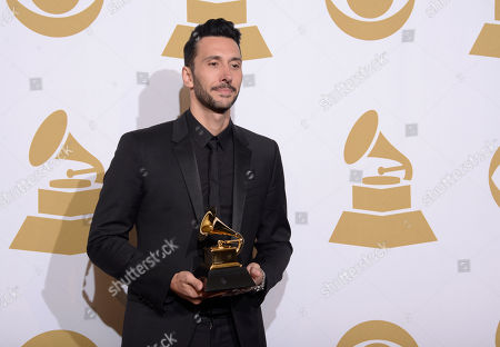 Cedric Gervais poses in the press room with the award for best remixed recording, non-classical at the 56th annual GRAMMY Awards at Staples Center, in Los Angeles