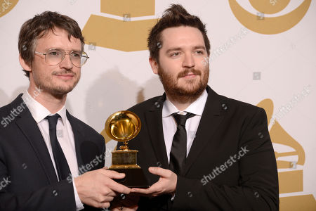 """Simon Earth, left, and James Musgrave poses in the press room with the award for best boxed or special limited edition package for """"Wings Over America"""" at the 56th annual GRAMMY Awards at Staples Center, in Los Angeles"""