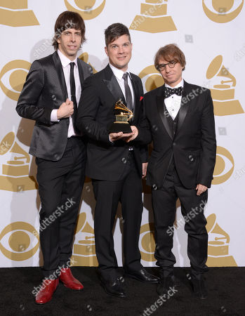 """From left, Sammy James Jr., Stephen Oremus and William Wittman pose in the press room with the award for best musical theater album for """"Kinky Boots"""" at the 56th annual GRAMMY Awards at Staples Center, in Los Angeles"""