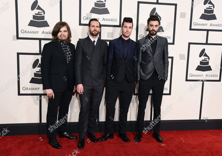 """Chris Wood Chris """"Woody"""" Wood, from left, Will Farquarson, Dan Smith, and Kyle J Simmons of Bastille arrive at the 57th annual Grammy Awards at the Staples Center, in Los Angeles"""